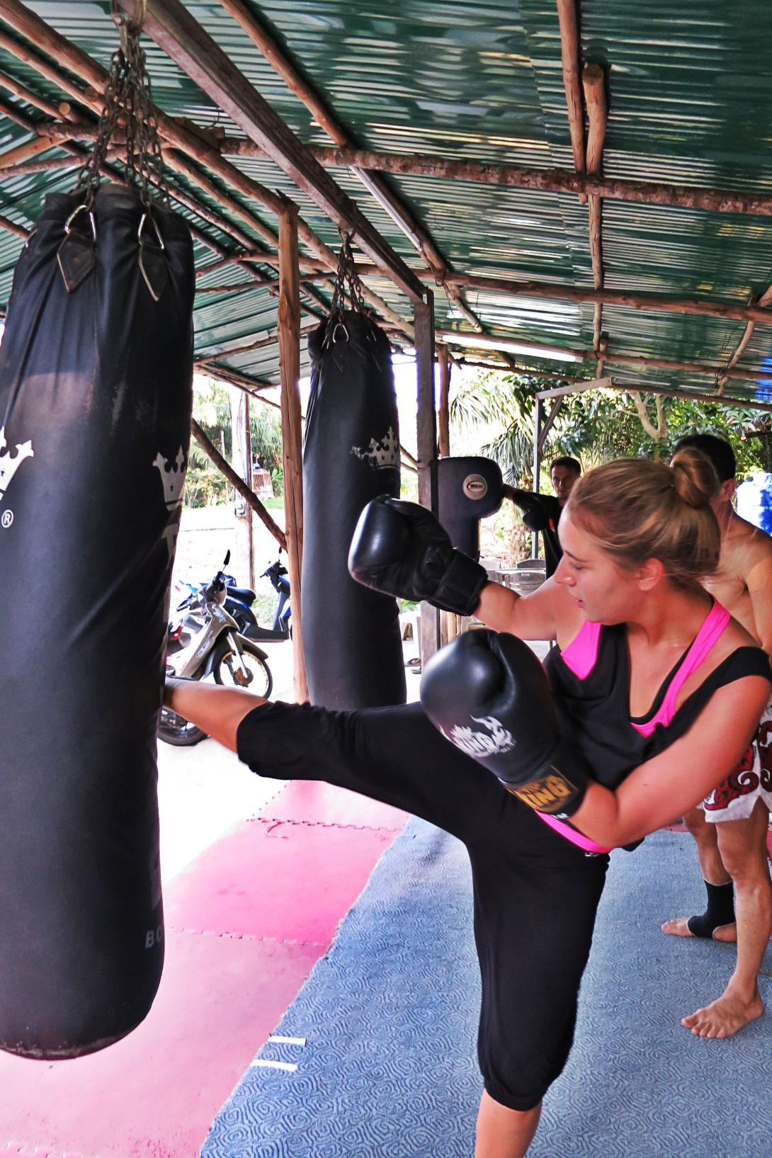 Female volunteer doing Muay Thai boxing as self-improvement